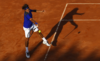 ROME, ITALY - MAY 12:  Roger Federer of Switzerland plays a forehand during his third round match against Richard Gasquet of France during day five of the Internazoinali BNL D'Italia at the Foro Italico Tennis Centre on May 12, 2011 in Rome, Italy.  (Phot