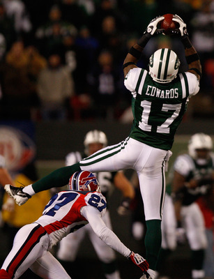 EAST RUTHERFORD, NJ - OCTOBER 18: Braylon Edwards #17 of the New York Jets makes a catch over Reggie Corner #27 of the Buffalo Bills during overtime on October 18, 2009 at Giants Stadium in East Rutherford, New Jersey. (Photo by Jared Wickerham/Getty Imag