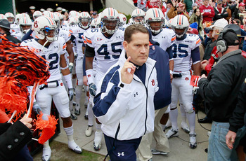 TUSCALOOSA, AL - NOVEMBER 26:  Head coach Gene Chizik of the Auburn Tigers leads his team onto the field to face the Alabama Crimson Tide at Bryant-Denny Stadium on November 26, 2010 in Tuscaloosa, Alabama.  (Photo by Kevin C. Cox/Getty Images)