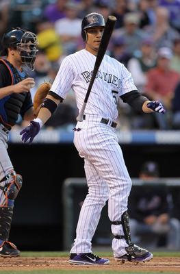 DENVER, CO - MAY 09:  Carlos Gonzalez #5 of the Colorado Rockies tosses his bat after a strike against starting pitcher Chris Capuano #38 of the New York Mets as Gonzalez struck out in the first inning at Coors Field on May 9, 2011 in Denver, Colorado.  (