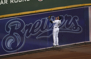 MILWAUKEE, WI - APRIL 04: Ryan Braun #8 of the Milwaukee Brewers watches as a home run ball hit by Martin Prado of the Atlanta Braves sails out of the park in the 8th inning during the home opener at Miller Park on April 4, 2011 in Milwaukee, Wisconsin. T