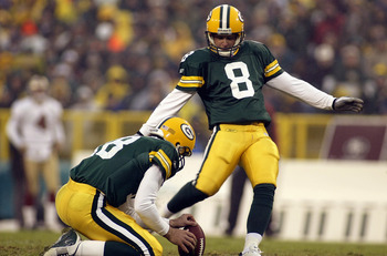 GREEN BAY, WI - November 23:  Kicker Ryan Longwell #8 of the Green Bay Packers kicks the ball during the game against the San Francisco 49ers on November 23, 2003 at Lambeau Field in Green Bay, Wisconsin.  The Pack defeated the Niners 20-10.  (Photo by Je