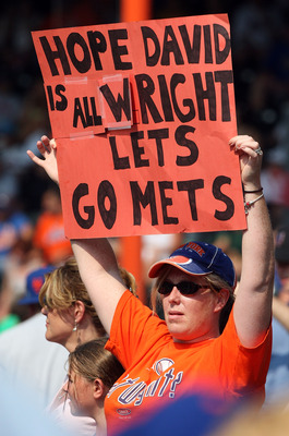 NEW YORK - AUGUST 16:  A fan of the New York Mets holds a banner in reference to injured player David Wright during the game against the San Francisco Giants on August 16, 2009 at Citi Field in the Flushing neighborhood of the Queens borough of New York C