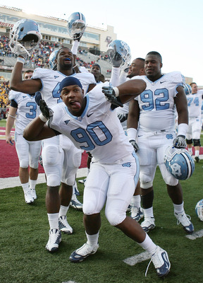 CHESTNUT HILL, MA - NOVEMBER 21:  Quinton Coples #90 of the North Carolina Tar Heels and the rest of his teammates celebrate the win over the Boston College Eagles on November 21, 2009 at Alumni Stadium in Chestnut Hill, Massachusetts. The Tar Heels defea