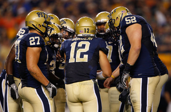 PITTSBURGH - SEPTEMBER 23:  Tino Sunseri #12 of the Pittsburgh Panthers calls a play in the huddle during the game against the Miami Hurricanes on September 23, 2010 at Heinz Field in Pittsburgh, Pennsylvania.  (Photo by Jared Wickerham/Getty Images)