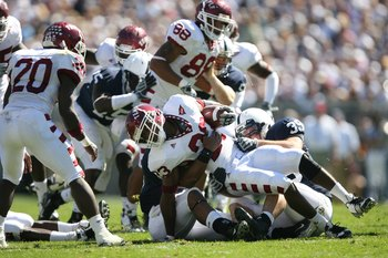 STATE COLLEGE, PA - SEPTEMBER 19: Wide receiver James Nixon #23 of the Temple Owls is tackled by defensive end Tom Golarz #39 of the Penn State Nittany Lions during a game on September 19, 2009 at Beaver Stadium in State College, Pennsylvania. (Photo by H