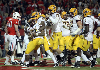 TUCSON, AZ - DECEMBER 02:  Quarterback Brock Osweiler #17 of the Arizona State Sun Devils celebrates with Cameron Marshall #26 after he scored a rushing touchdown against the Arizona Wildcats during the double overtime of the college football game at Ariz