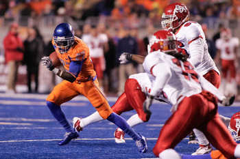 BOISE, ID - NOVEMBER 19:  Jeremy Avery #27 of the Boise State Broncos runs the ball against the Fresno State Bulldogs at Bronco Stadium on November 19, 2010 in Boise, Idaho.  (Photo by Otto Kitsinger III/Getty Images)