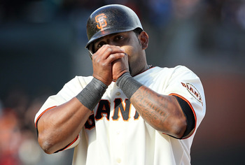 SAN FRANCISCO, CA - APRIL 08:  Pablo Sandoval #48 of the San Francisco Giants warms his hands after hitting an RBI single during the ninth inning against the St. Louis Cardinals at AT&T Park on April 8, 2011 in San Francisco, California. The Giants beat t