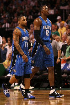 BOSTON - MAY 24:  (L-R) Jameer Nelson #14 and Dwight Howard #12 of the Orlando Magic walk towards the bench against the Boston Celtics in Game Four of the Eastern Conference Finals during the 2010 NBA Playoffs at TD Banknorth Garden on May 24, 2010 in Bos