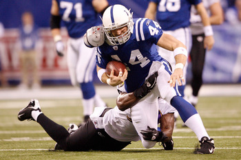 INDIANAPOLIS - JANUARY 16:  Tight end Dallas Clark #44 of the Indianapolis Colts is tackled after a first quarter catch against the Baltimore Ravens in the AFC Divisional Playoff Game at Lucas Oli Stadium on January 16, 2010 in Indianapolis, Indiana.  (Ph