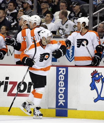 PITTSBURGH, PA - MARCH 29:  Ville Leino #22 of the Philadelphia Flyers celebrates his second third period goal against the Pittsburgh Penguins at Consol Energy Center on March 29, 2011 in Pittsburgh, Pennsylvania.  The Flyers defeated the Penguins 5-2.  (