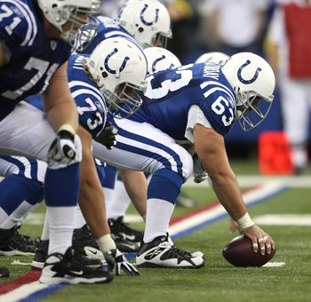 INDIANAPOLIS - NOVEMBER 04:  Offensive center Jeff Saturday #63 of the Indianapolis Colts readies the ball for the snap against the New England Patriots on November 4, 2007 at the RCA Dome in Indianapolis, Indiana. The Patriots won 24-20. (Photo by Andy L