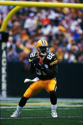 12 Sep 1999:  Desmond Howard #82 of the Green Bay Packers is in action during the game against the Oakland Raiders at Lambeau Field in Green Bay, Wisconsin. The Packers defeated the Raiders 28-24. Mandatory Credit: Brian Bahr  /Allsport