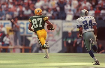 14 JAN 1996:  WIDE RECEIVER ROBERT BROOKS #87 OF THE GREEN BAY PACKERS RUNS AWAY FROM CORNERBACK LARRY BROWN #24 OF THE DALLAS COWBOYS FOR A 73-YARD TOUCHDOWN RECEPTION DURING THE FIRST QUARTER OF THE NFC CHAMPIONSHIP GAME AT TEXAS STADIUM IN IRVING, TEXA