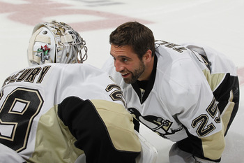 SUNRISE, FL - APRIL 2: Maxime Talbot #25 talks to goaltender Marc-Andre Fleury #29 of the Pittsburgh Penguins prior to the NHL game against the Florida Panthers on April 2, 2011 at the BankAtlantic Center in Sunrise, Florida. (Photo by Joel Auerbach/Getty
