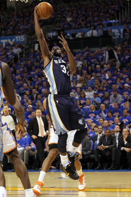 OKLAHOMA CITY, OK - MAY 15:  Guard O.J. Mayo #32 of the Memphis Grizzlies takes a shot against the Oklahoma City Thunder in Game Seven of the Western Conference Semifinals in the 2011 NBA Playoffs on May 15, 2011 at Oklahoma City Arena in Oklahoma City, O