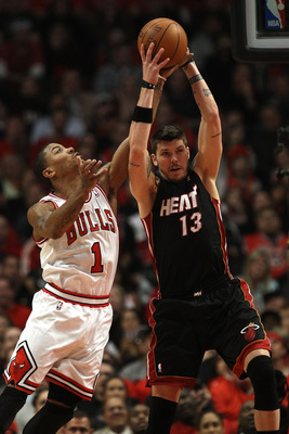 CHICAGO, IL - MAY 15:  Mike Miller #13 of the Miami Heat grabs a rebound against Derrick Rose #1 of the Chicago Bulls in Game One of the Eastern Conference Finals during the 2011 NBA Playoffs on May 15, 2011 at the United Center in Chicago, Illinois. The
