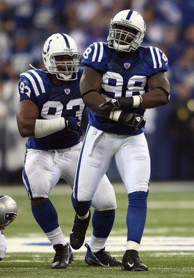 INDIANAPOLIS - NOVEMBER 04:  Robert Mathis #98 and Dwight Freeney #93 of the Indianapolis Colts react after Mathis sacked Tom Brady #12 of the New England Patriots in the third quarter of their game on November 4, 2007 at the RCA Dome in Indianapolis, Ind