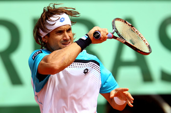 PARIS, FRANCE - MAY 22:  David Ferrer of Spain plays a forehand during the men's singles round one match  between David Ferrer of Spain and Jarkko Nieminen of Finland on day one of the French Open at Roland Garros on May 22, 2011 in Paris, France.  (Photo