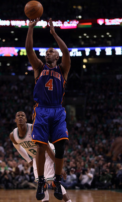 BOSTON, MA - APRIL 17:  Chauncey Billups #4 of the New York Knicks takes a shot as Rajon Rondo #9 of the Boston Celtics defends in Game One of the Eastern Conference Quarterfinals in the 2011 NBA Playoffs on April 17, 2011 at the TD Garden in Boston, Mass