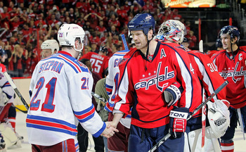 WASHINGTON , DC - APRIL 23:  Jason Arnott #44 of the Washington Capitals greets Derek Stepan #21 of the New York Rangers during the handshake following a 3-1 win over the Rangers in Game Five of the Eastern Conference Quarterfinals during the 2011 NHL Sta