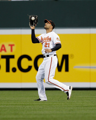 BALTIMORE, MD - APRIL 28: Right fielder Nick Markakis #21 of the Baltimore Orioles makes a catch against the Boston Red Sox at Oriole Park at Camden Yards on April 28, 2011 in Baltimore, Maryland.  (Photo by Rob Carr/Getty Images)