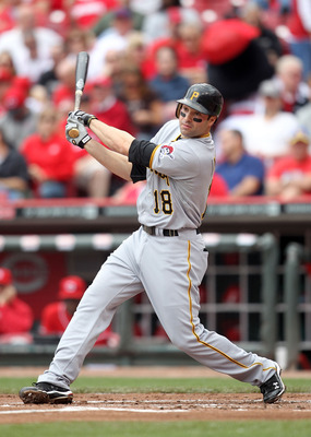 CINCINNATI, OH - MAY 19: Neil Walker #18 of the Pittsburgh Pirates hits a double during the game against the Cincinnati Reds at Great American Ball Park on May 19, 2011 in Cincinnati, Ohio.  The Pirates won 5-3. (Photo by Andy Lyons/Getty Images)