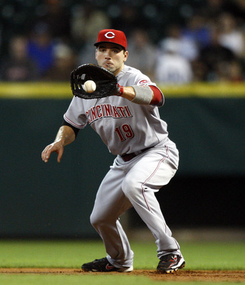HOUSTON - MAY 11: First baseman Joey Votto #19 of the Cincinnati Reds fields a ground ball during  a baseball game against the Houston Astros at Minute Maid Park on May 11, 2011 in Houston, Texas.  (Photo by Bob Levey/Getty Images)