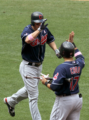 ANAHEIM, CA - MAY 8:  Grady Sizemore #24 of the the Cleveland Indians is greeted by Shin-Soo Choo #17 after his solo home run in the fifth inning against the Los Angeles Angels of Anaheim on May 8, 2011 at Angel Stadium in Anaheim, California.  (Photo by