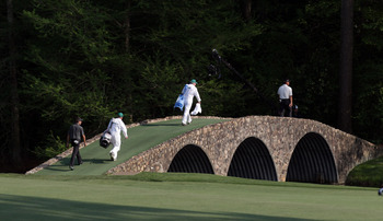AUGUSTA, GA - APRIL 10:  Charl Schwartzel of South Africa makes his way over Hogan Bridge during the final round of the 2011 Masters Tournament at Augusta National Golf Club on April 10, 2011 in Augusta, Georgia.  (Photo by Ross Kinnaird/Getty Images for