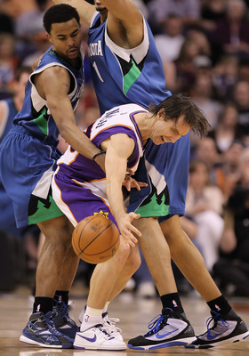 PHOENIX - MARCH 16:  Steve Nash #13 of the Phoenix Suns looses control on the ball while being guarded by Ramon Sessions #7 of the Minnesota Timberwolves during the NBA game at US Airways Center on March 16, 2010 in Phoenix, Arizona. The Suns defeated the