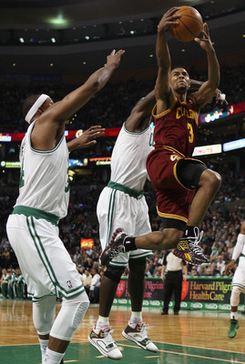 BOSTON, MA - JANUARY 25:  Ramon Sessions #3 of the of the Cleveland Cavaliers takes a shot as Paul Pierce #34 and Kevin Garnett #5 of the Boston Celtics defend on January 25, 2011 at the TD Garden in Boston, Massachusetts.   NOTE TO USER: User expressly a