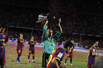BARCELONA, SPAIN - MAY 15:  Goalkeeper Victor Valdes of FC Barcelona holds up the La Liga trophy after the La Liga match between Barcelona and Deportivo La Coruna at Camp Nou Stadium on May 15, 2011 in Barcelona, Spain.  (Photo by David Ramos/Getty Images