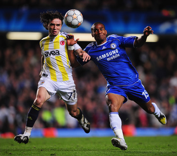 LONDON - APRIL 08:  Florent Malouda of Chelsea challenges Gokhan Gonul of Fenerbahce during the UEFA Champions League Quarter Final 2nd Leg match between Chelsea and Fenerbahce at Stamford Bridge on April 8, 2008 in London, England.  (Photo by Shaun Botte