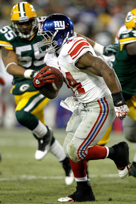 GREEN BAY, WI - DECEMBER 26: Ahmad Bradshaw #44 of the New York Giants carries the ball against the Green Bay Packers at Lambeau Field on December 26, 2010 in Green Bay, Wisconsin.  (Photo by Matthew Stockman/Getty Images)