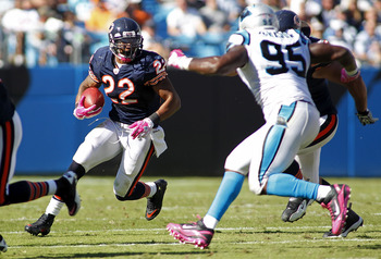 CHARLOTTE, NC - OCTOBER 10: Running back Matt Forte #22 of the Chicago Bears runs with the ball as defensive end Charles Johnson #95 of the Carolina Panthers defends at Bank of America Stadium on October 10, 2010 in Charlotte, North Carolina. (Photo by Ge