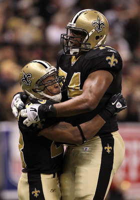 NEW ORLEANS - JANUARY 24:  Pierre Thomas #23 of the New Orleans Saints celebrates with teammate Jermon Bushrod #74 after scoring a touchdown on a 38-yard pass play in the first quarter against the Minnesota Vikings during the NFC Championship Game at the