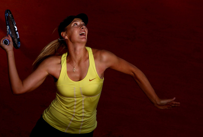 ROME, ITALY - MAY 15:  Maria Sharapova of Russia serves during the final against Samantha Stosur of Australia during day eight of the Internazoinali BNL D'Italia at the Foro Italico Tennis Centre on May 15, 2011 in Rome, Italy.  (Photo by Clive Brunskill/