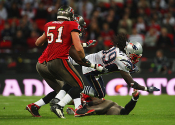 LONDON, ENGLAND - OCTOBER 25:  Laurence Maroney (#39) of the New England Patriots  is tackled by Barrett Ruud (#51) of Tampa Bay Buccaneers during the NFL International Series match between New England Patriots and Tampa Bay Buccaneers at Wembley Stadium