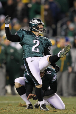 PHILADELPHIA, PA - JANUARY 09:  David Akers #2 kicks as Sav Rocca #6 of the Philadelphia Eagles holds against the Green Bay Packers during the 2011 NFC wild card playoff game at Lincoln Financial Field on January 9, 2011 in Philadelphia, Pennsylvania.  (P