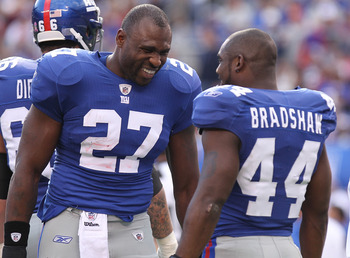 EAST RUTHERFORD, NJ - OCTOBER 17:  Brandon Jacobs #27 of the New York Giants talks with Ahmad Bradshaw #44 against the Detroit Lions at New Meadowlands Stadium on October 17, 2010 in East Rutherford, New Jersey.  (Photo by Nick Laham/Getty Images)
