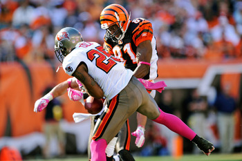 CINCINNATI, OH - OCTOBER 10:  Aqib Talib #25 of the Tampa Bay Buccaneers steps in front of Terrell Owens #81 of the Cincinnati Bengals to make an interception at Paul Brown Stadium on October 10, 2010 in Cincinnati, Ohio. Tampa Bay intercepted the Bengals