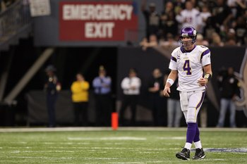 NEW ORLEANS - JANUARY 24:  Brett Favre #4 of the Minnesota Vikings walks on the field under a sign which reads 'Emergency Exit' against the New Orleans Saints during the NFC Championship Game at the Louisiana Superdome on January 24, 2010 in New Orleans,
