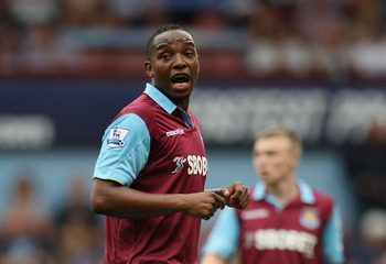 LONDON, ENGLAND - AUGUST 21:  Benni McCarthy  of West Ham Unitedspeaks to team mates during the Barclays Premier League match between West Ham United and Bolton Wanderers at the Boleyn Ground on August 21, 2010 in London, England.  (Photo by Phil Cole/Get