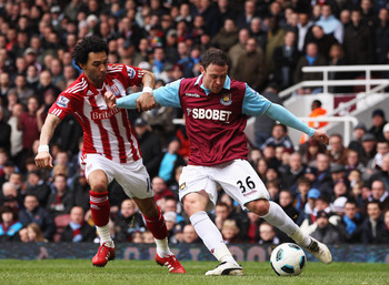 LONDON, UNITED KINGDOM - MARCH 05:  Wayne Bridge (R) of West Ham United holds off the challenge of Jermaine Pennant (L) of Stoke City during the Barclays Premier League match between West Ham United and Stoke City at the Boleyn Ground on March 5, 2011 in