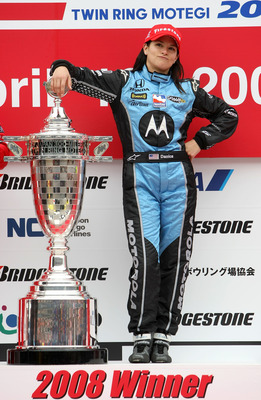 MOTEGI, JAPAN - APRIL 20:  Danica Patrick driver of the #7 Motorola Andretti Green Racing Honda Dallara poses with the trophy after winning the IndyCar Series Bridgestone Indy Japan 300 Mile on April 20, 2008 at Twin Ring Motegi in Motegi, Japan.  (Photo