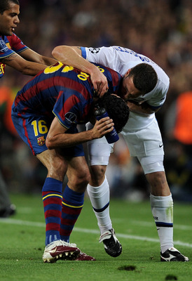 Thiago Motta seeks an answer from the 'injured' Sergio Busquets after the Spaniard got him sent off.