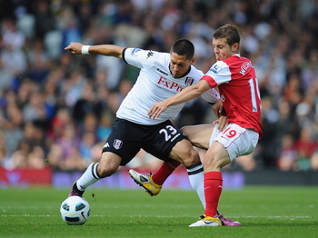 LONDON, ENGLAND - MAY 22:  Clint Dempsey of Fulham holds off a challenge from Jack Wilshere of Arsenal during the Barclays Premier League match between Fulham and Arsenal at Craven Cottage on May 22, 2011 in London, England.  (Photo by Clive Mason/Getty I
