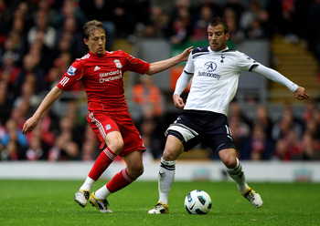 LIVERPOOL, ENGLAND - MAY 15:  Lucas of Liverpool and Rafael Van der Vaart of Spurs compete for the ball during the Barclays Premier League match between Liverpool and Tottenham Hotspur at Anfield on May 15, 2011 in Liverpool, England.  (Photo by Michael S